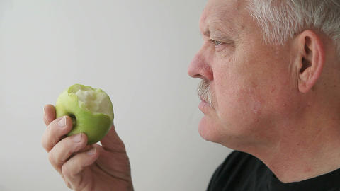 man eats green apple Stock Video Footage