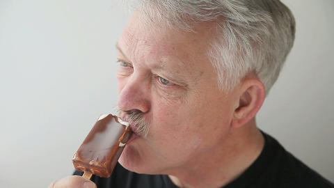 older man with ice cream Stock Video Footage