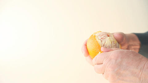Man Peeling Orange stock footage