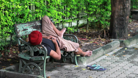 homeless man sleep on bench Stock Video Footage