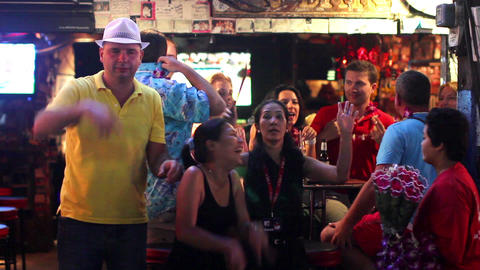 People entertaining at bar Stock Video Footage
