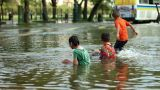Children play in flood Footage