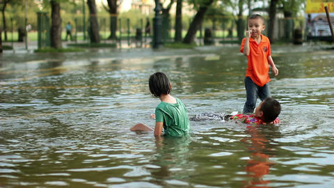 Children play in flood Stock Video Footage