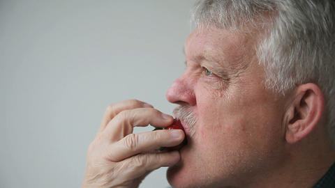 man eats fresh strawberry Footage