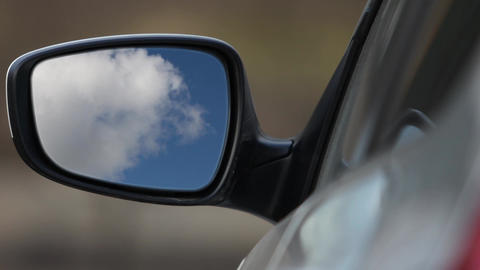 Rear view mirror reflecting sky Live Action