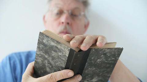 Man Looking Through A Book stock footage