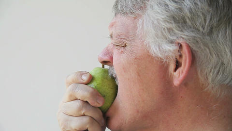man tries to eat unripe pear Footage