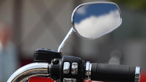 motorcycle Rear view mirror reflecting sky Live Action