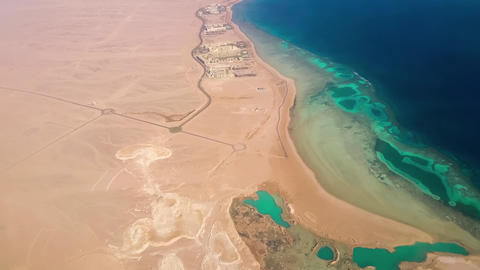Aerial View from the Aircraft to Desert and Sea, sunny day Footage