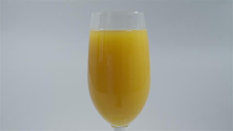 Pouring a glass of orange juice. 4K UHD Footage