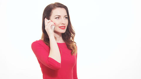 Attractive Female In Red Clothes Talking On The Mobile Phone Surprised With Happ Footage