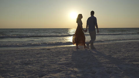 Couple Walking on Beach at Sunset (7 of 23) Footage