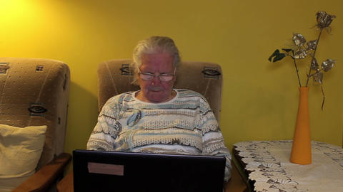 Elderly woman using laptop computer Footage
