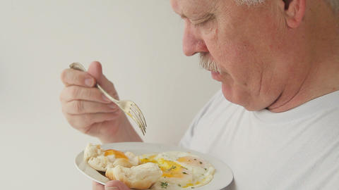 Man Eats Eggs And Biscuit Breakfast stock footage