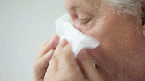 Older Man Blows His Nose stock footage