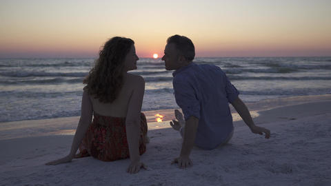 Couple Relaxing on Beach at Sunset (4 of 5) Footage