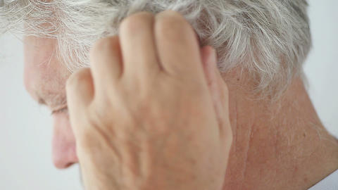 ear discomfort in older man Footage