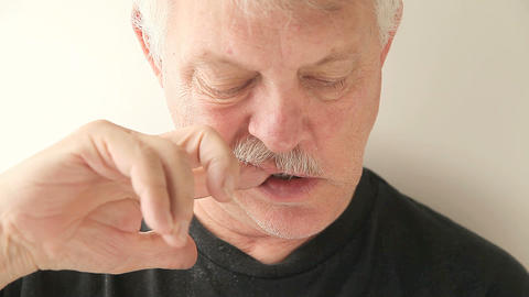 man using finger to clean teeth Live Action