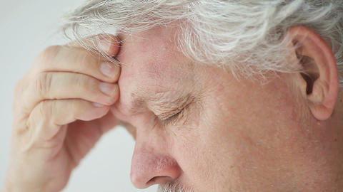 closeup of man with head pain Footage
