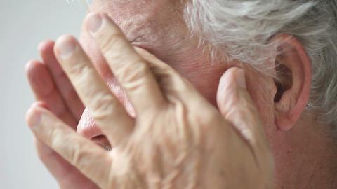 senior man rubs his eyes Footage