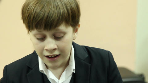 Boy plays piano and sings Footage
