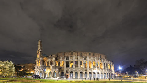 View of the Colosseum. Night. Rome, Italy. Time Lapse. 4K Footage