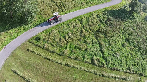 Tractor aerial view. Tractor on a pass in the alps of Austria Footage