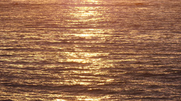 Golden Waving Sea Waters At Sunrise stock footage