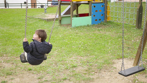 Baby Toddler Swinging on the Park Swing Footage