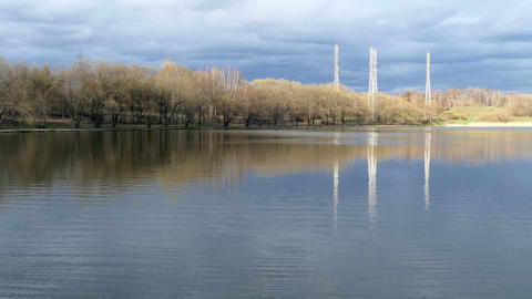 Lake in the city with reflection of clouds in the spring UHD Footage