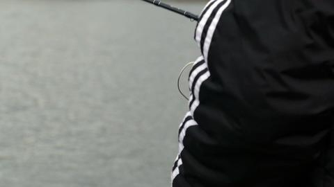 Fishing Spinning coil rod hand and water Footage