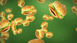 Cheeseburgers flying on green Stock Video Footage