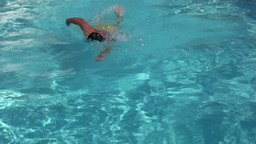 Man dive and swim in pool Stock Video Footage
