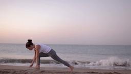 yoga girl beach sunrise helathy lifestyle Footage