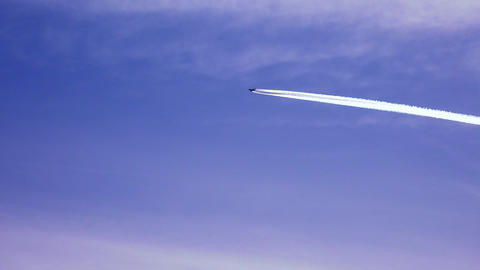 The Plane Leaves A Trail In The Sky. 4K stock footage