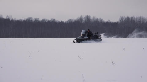 Snowmobile Rides On Winter Field. 4K stock footage