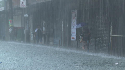 People Wade In Extreme Flood Waters In Manila Philippines Footage