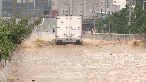 Truck Drives Through Flooded Road In Manila Philippines Footage