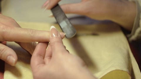 A Woman Gets Her Sawing Nails Footage