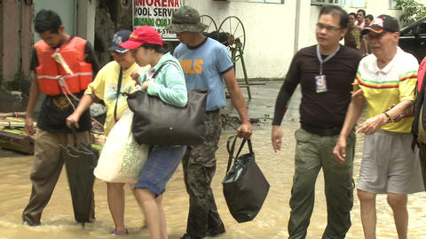 Elderly Couple Rescued From Flooding In Manila Philippines Footage