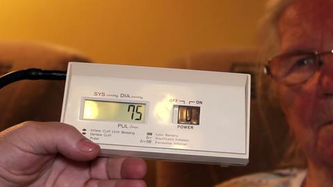 Electronic meter measuring blood pressure Live Action