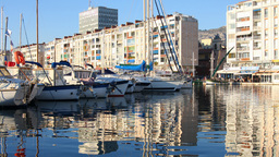 port harbour reflection buildings and boats water ripples Footage