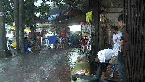 People Scoop Water From Flooded Property Footage
