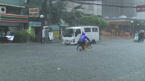 Man Cycles Through Flood Waters In Downtown Manila Philippines Footage