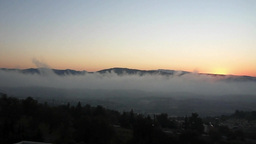 Early Morning Fog Along The Valley In Cyprus. In The Back The Troodos Mountains stock footage