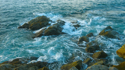 Evening landscape. The rocky coast of the ocean. Waves and large stones Footage