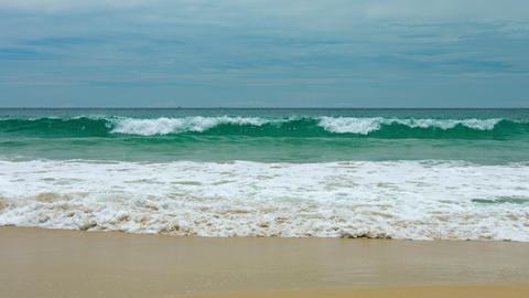 Surf on a tropical sandy seashore Footage