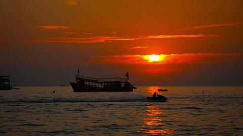 Boat at Anchor and Jetski at Sunset in Sihanoukville. Cambodia Footage