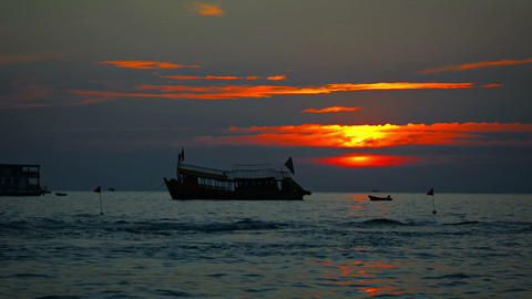 Anchored Boat and Fast Jetski at Sunset in Sihanoukville. Cambodia Footage