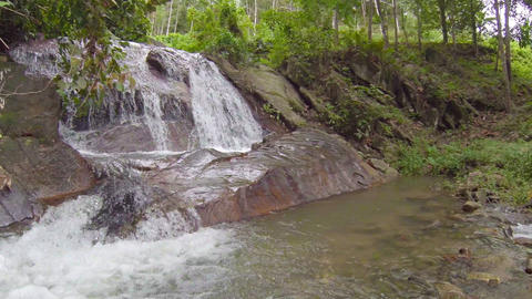 Beautiful Natural Waterfall Cascading over Rocks in Thailand Footage
